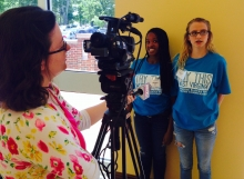 Youth from Logan being interviewed by news media