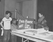 Children supporting the This House Not For Sale program
