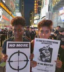 Two protesters in Times Square in solidarity with Ferguson