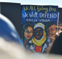We All Belong Here sign at Women's March in Iowa 2018