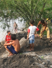 sand miners by river bed