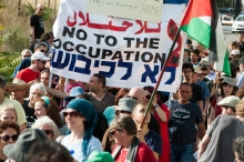 "Palestinians march with ""No to the occupation"" sign"