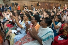 A room of women applaud during a presentation
