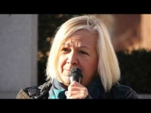 """Eva Castillo at """"Stand with Refugees"""" rally"""