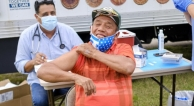 Man receiving vaccination in South Dade clinic.