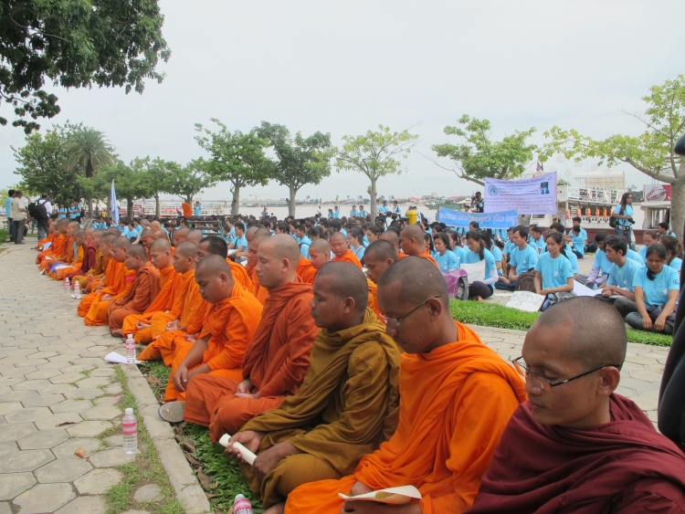 Monks sitting at International Day of Peace