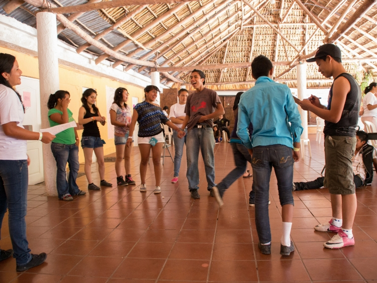 Young people engage in indoor group activity at the Peace Exchange camp