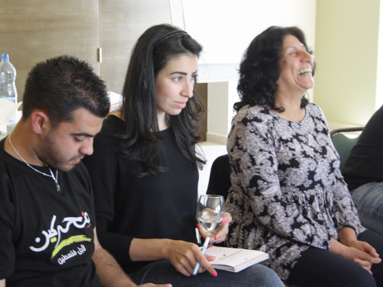 The facilitator (right) helps young activists discuss and interact. March 2015.