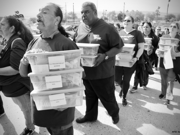 Flu shot delivery in San Ysidro, marching with supplies