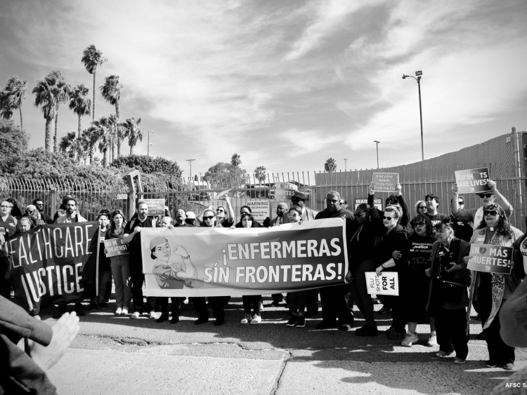 Flu shot delivery in San Ysidro, activists and banners