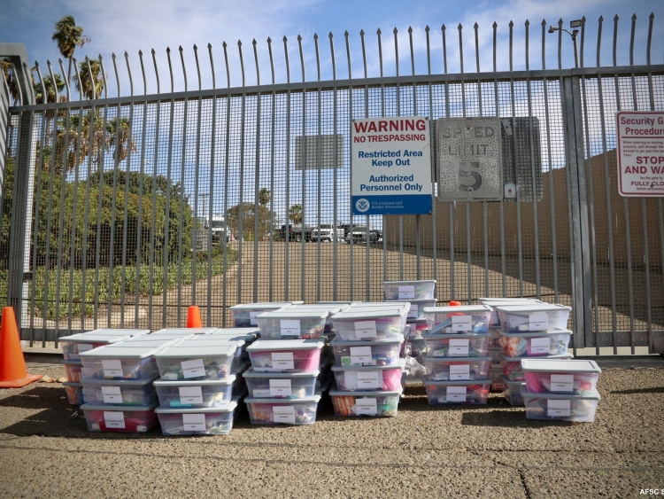 Flu shot delivery in San Ysidro, boxes in front of gate