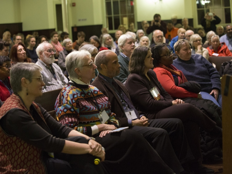 Corporation members and community members listen to Rev. Barber's Thursday night presentation