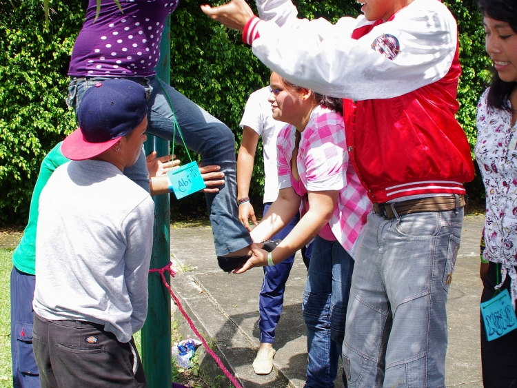 People at peace exchange camp engage in a trust building activity