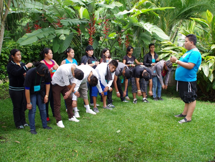 Young people stand in a line outside as part of camp activity