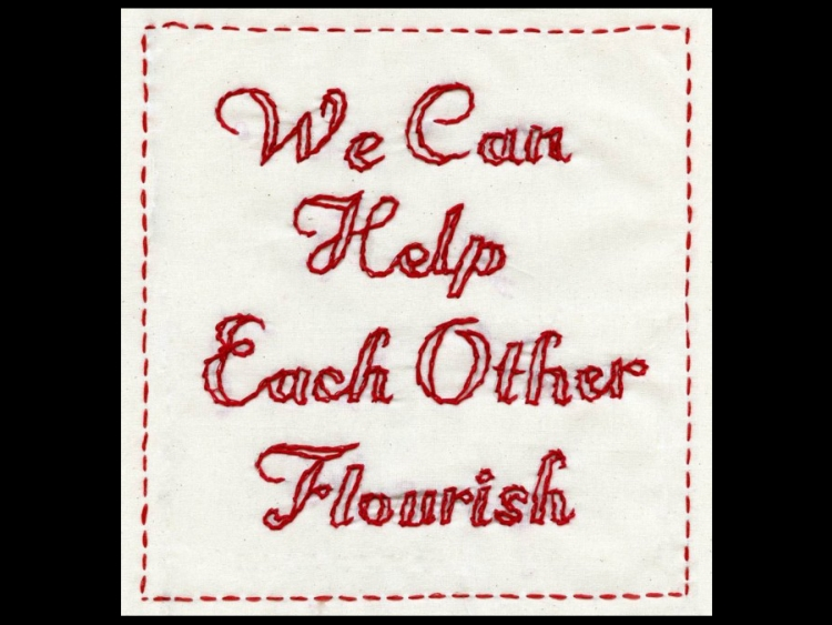 """Poster reading """"we can help each other flourish"""""""