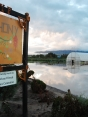 """Water rising next to """"Anthony Farm"""" sign"""