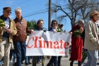 People marching with climate justice sign
