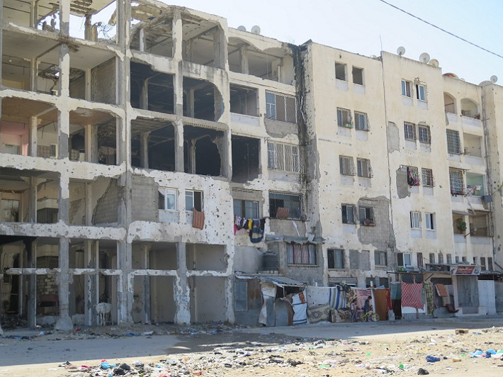 Building with holes occupied in Gaza
