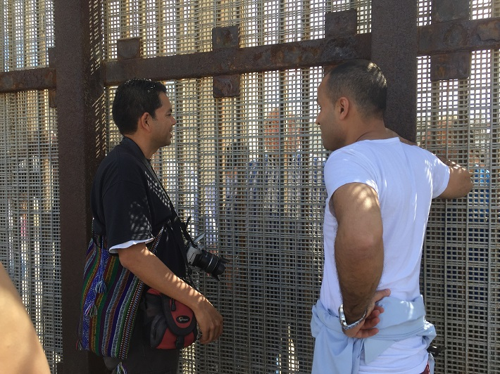 Mohammed Omer and Pedro Rios at the border wall