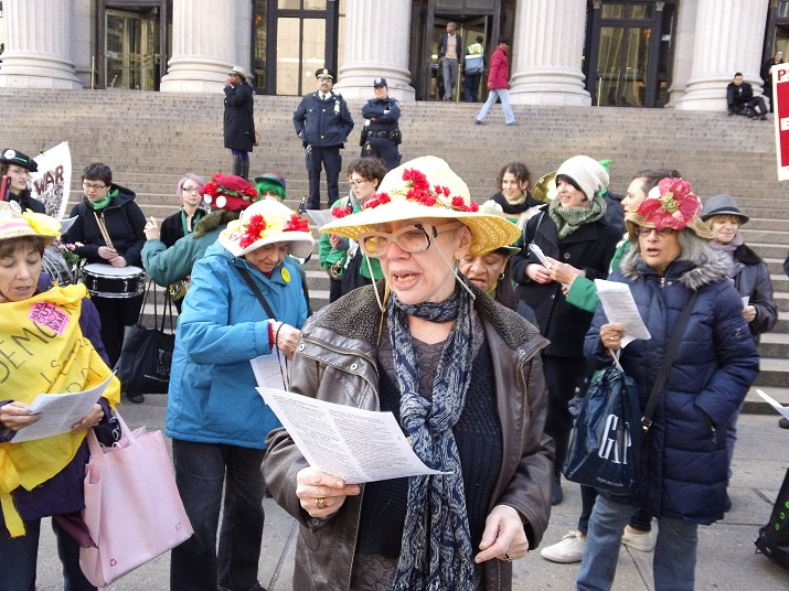 New York War Tax Resistors League action in 2013 with the Rude Mechanical Orchestra and Raging Grannies, photo by All-Night Images via Flickr CC