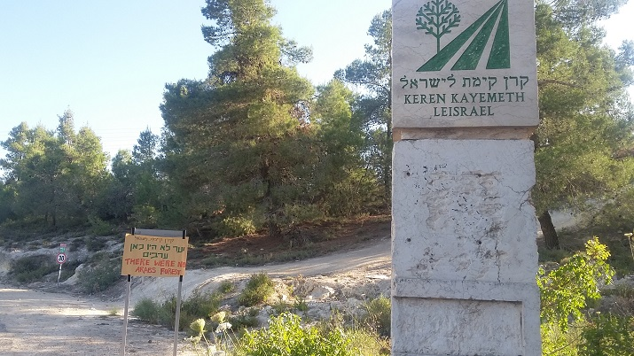 Satirical signs replacing JNF forest signs near Jerusalem as part of the international week of action, May 25, 2016