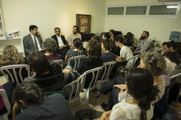 Two Palestinian lawyers representing Palestinian families under threat of evictions by the JNF in East Jerusalem, explaining the legal situation in an event in Jerusalem as part of the global week of action, May 24, 2016