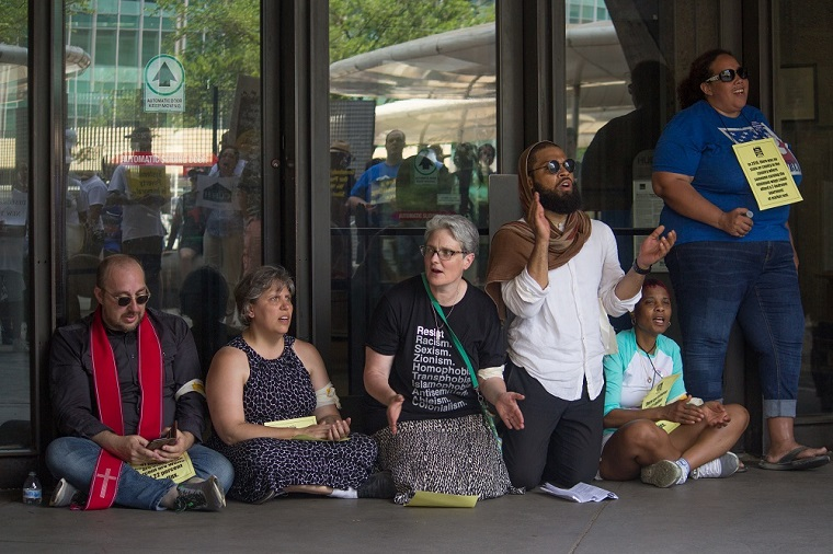 Chanting and singing at HUD while blocking the doors, photo by Carl Roose
