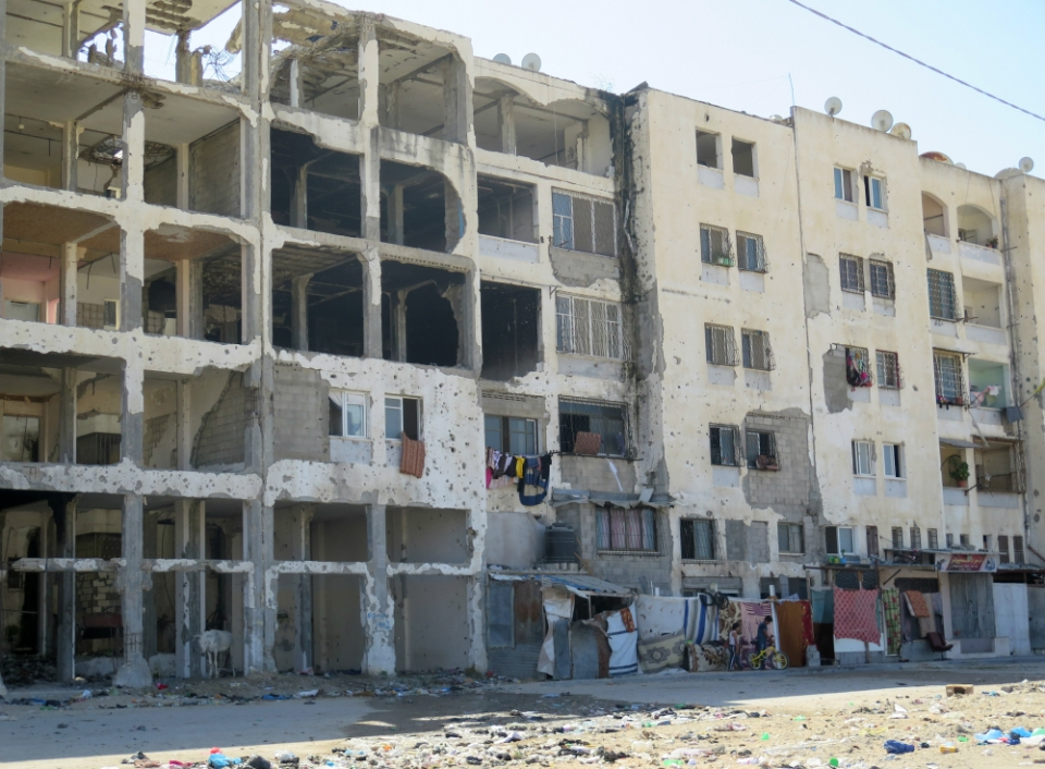 Many structures damaged during the 2014 Gaza war, including this apartment block, remain in ruins today. Photo: AFSC/Mike Merryman-Lotze