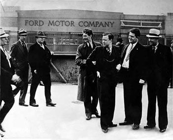 Reuther (third from right) at a worker strike at Ford Motor Company. Photo: Public domain