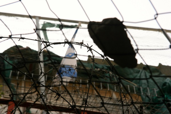 A rock caught on the wire mesh that protects Palestinians shops from debris thrown from Israeli settlements above.