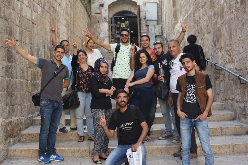 Young Palestinian participants from Gaza went on a tour in Jerusalem accompanied by our partner Pal Vision, after meeting with other participants from Israel and West Bank. Their meeting was held between 4-8 June 2015 in Nablus. For most of the Gazans, this is their first time out of Gaza and first time in Jerusalem too. The tour comprised of 14 Gaza participants who were awarded permits to exit Gaza. Unfortunately, a fifth participant, Yasser, was also awarded a permit to exit but was detained at the Israeli military checkpoint until further notice.