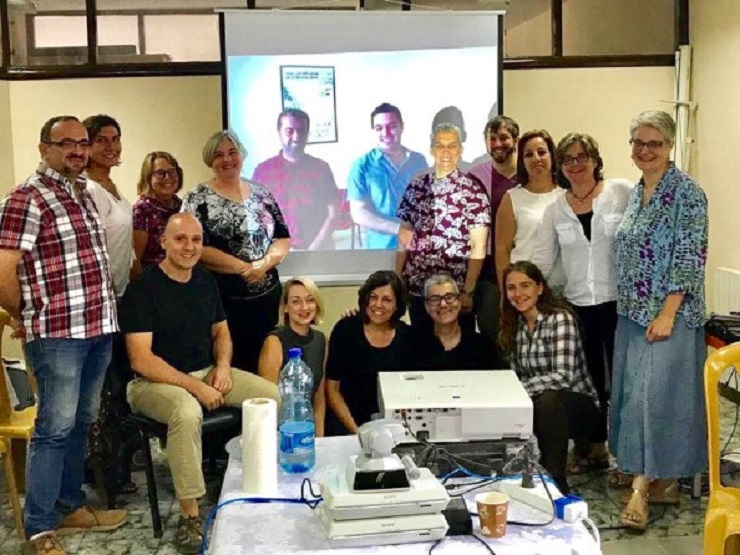 AFSC Israel/Palestine staff meeting in Ramallah (with Ali and Firas joining us from Gaza via Skype) // Photo credit: Brant Rosen